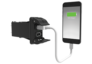 V-Charger with curved, spring loaded double doors in open position; indicator light shows green while charging mobile phone.